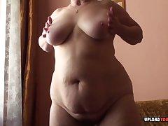 Granny nigh big tits displays her body