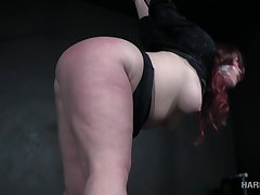 Voluptuous redheaded bitch with a big ass gets punished by her bondage master
