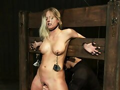 Bound blonde in steel anal fucked
