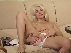 Blonde mature plays with her wet snatch in a soft unexcelled