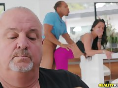 Teen gets fucked by a dusky dude with her daddy around